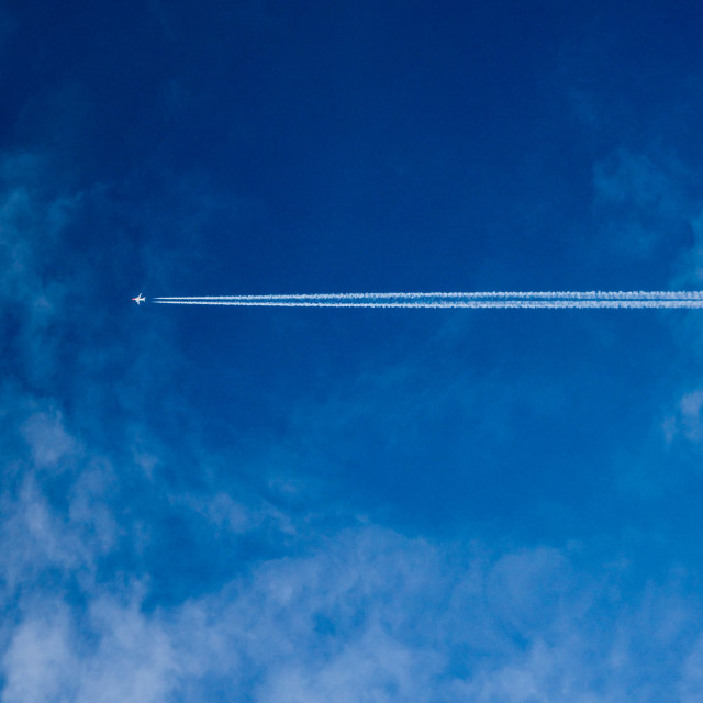 """Jet, Con Trail & Cloud."" stock image"