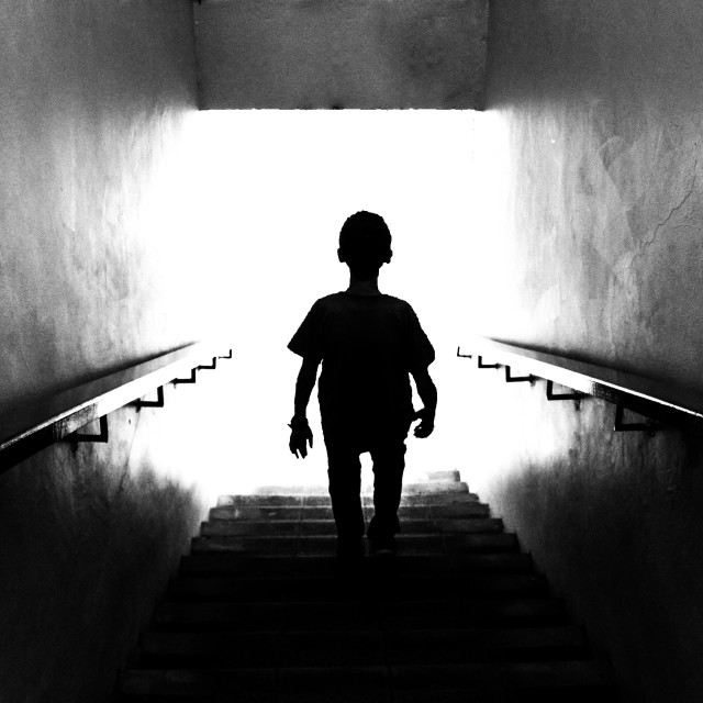 """""""Stepping into the light"""" stock image"""