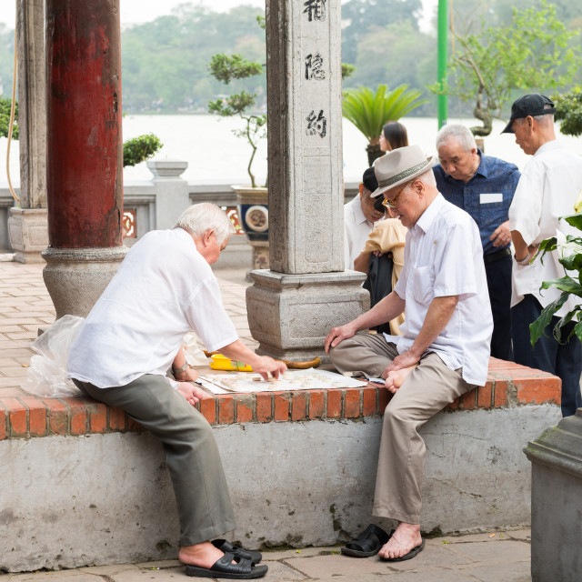 """""""Older people playing street chess"""" stock image"""