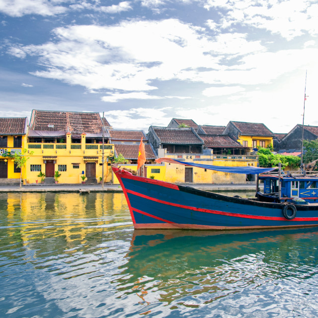 """""""Wooden boats on the Thu Bon River in Hoi An Ancient Town (Hoian), Vietnam."""" stock image"""