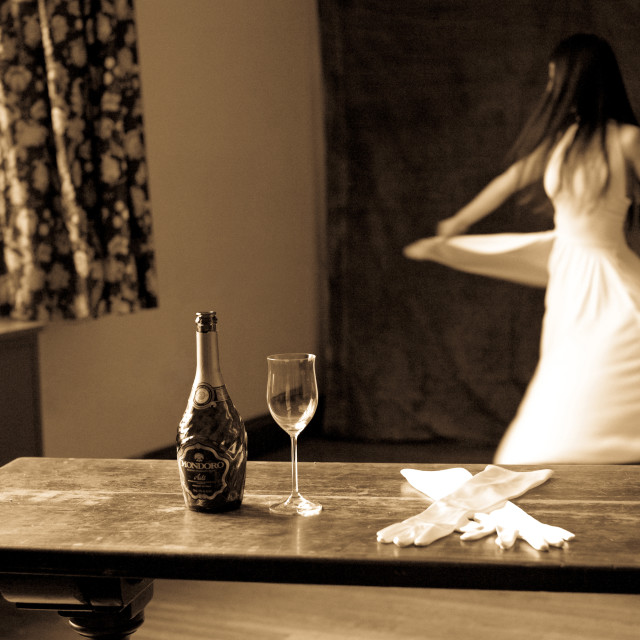 """Woman Dancing in White Dress with Champagne"" stock image"