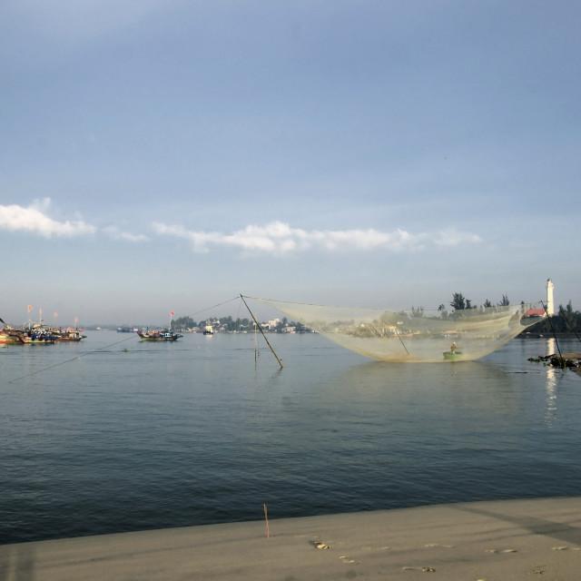 """Fish net at Dai Beach (Cua Dai) fin the morning in Hoi An, Danang, Vietnam"" stock image"
