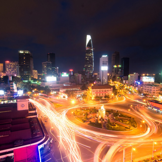 """Night traffic around Quach Thi Trang park, Ben Thanh market in Ho Chi Minh city, Vietnam"" stock image"