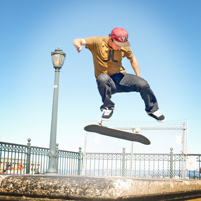 """Doing tricks with a skateboard"" stock image"