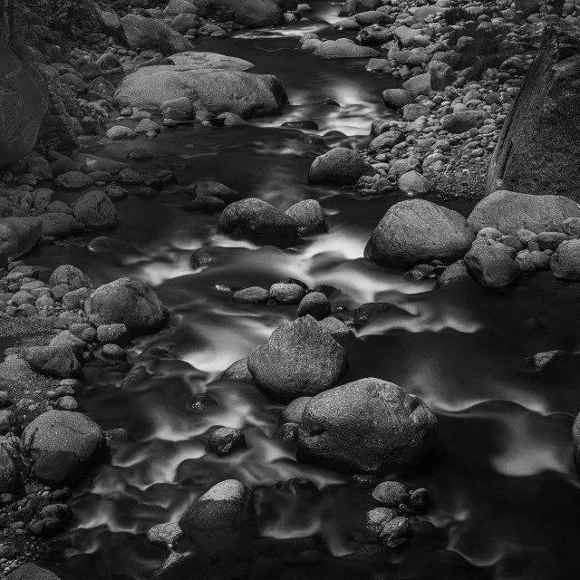 """""""Flowing through Boulders"""" stock image"""