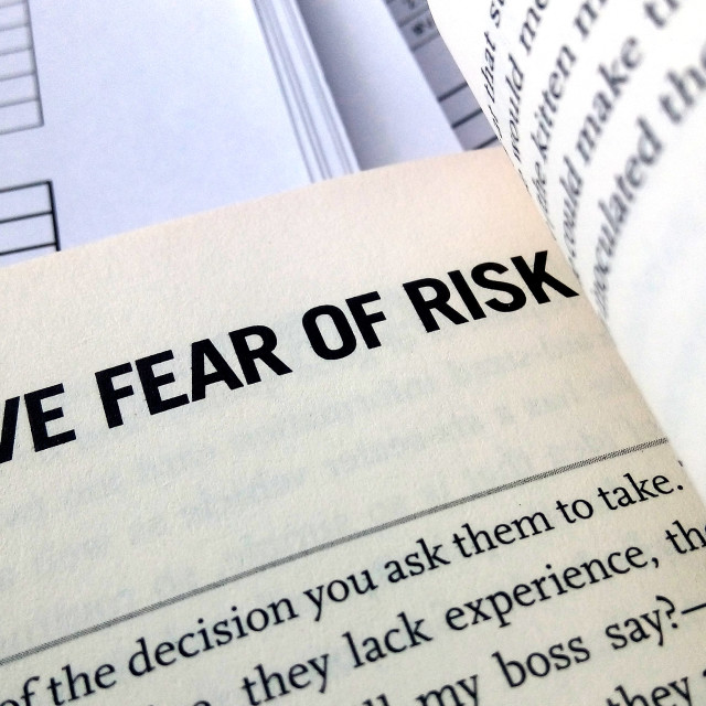 """""""Remove fear of risk word on the book"""" stock image"""