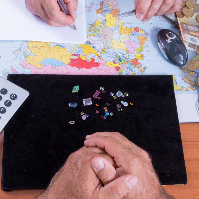 """""""Customer and seller negotiate the purchase of a batch of precious stones..."""" stock image"""