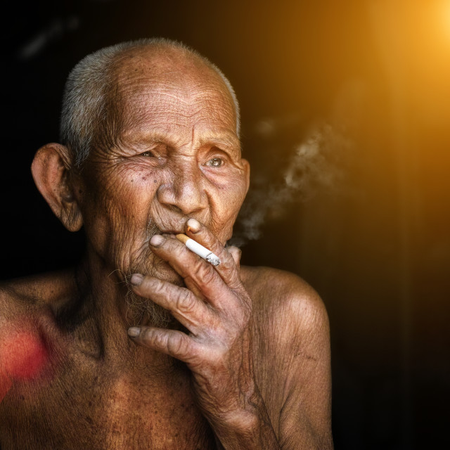 """The old man was smoking"" stock image"