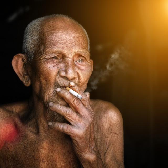 """The old man was smoking"" stock image"