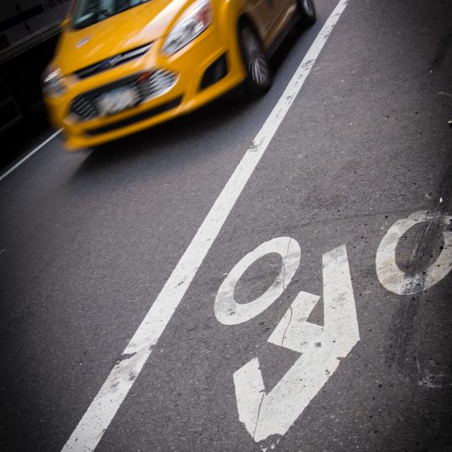 """Yellow cab and Bicycle lane"" stock image"