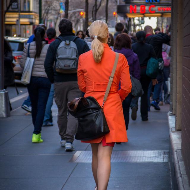 """Woman in Orange Trench coat"" stock image"