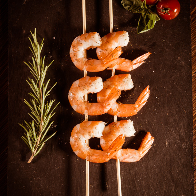 """Prawn skewers with thyme and Tomatoes"" stock image"