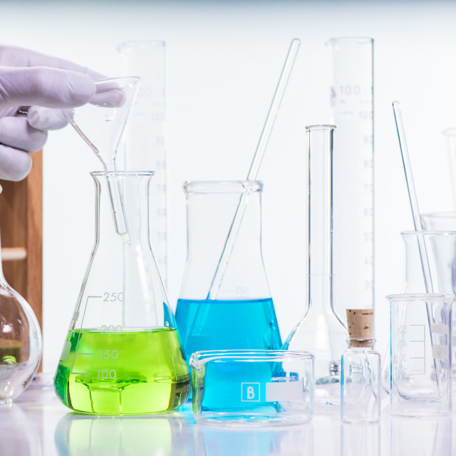 """""""Liquid drop from laboratory glass pipette to test tube"""" stock image"""