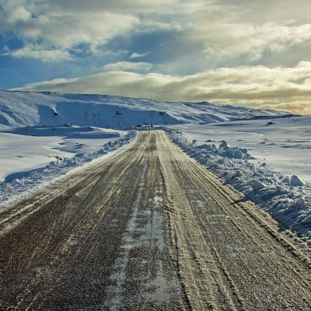 """Icelandic road in the snow"" stock image"