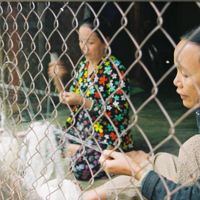 """""""Knitting fishing nets"""" stock image"""