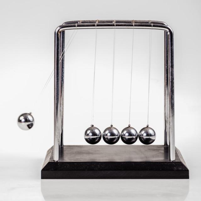 """Moving Newton's cradle"" stock image"
