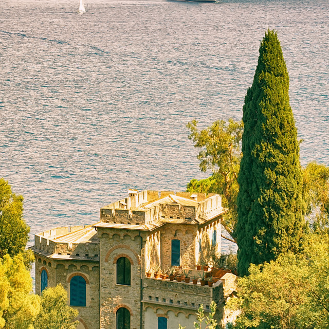 """Small Castle Overlooking the Water in Portofino with a cruise ship in the distance"" stock image"