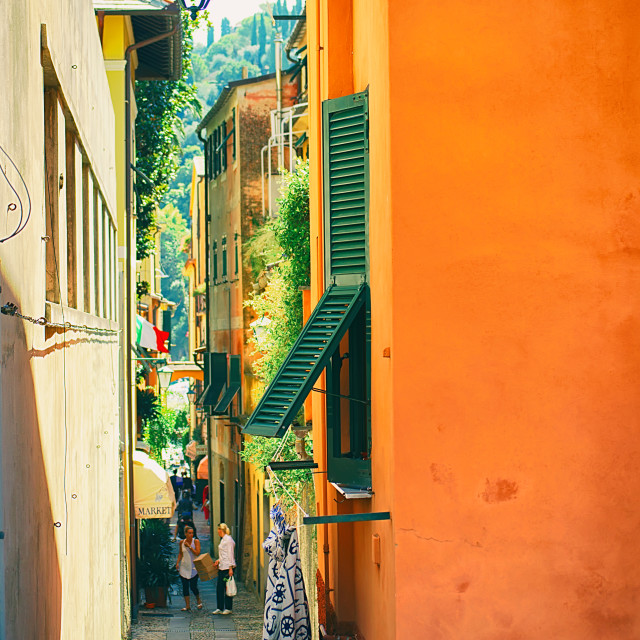 """Backstreet in Portofino with clothes hanging from a window"" stock image"