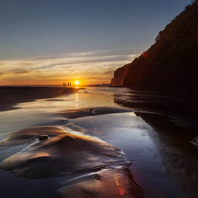 """Sunset at Bethells, West Coast Beach, New Zealand ..."" stock image"