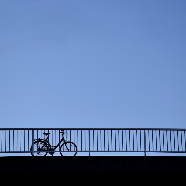 """""""Lone bicycle on a Bridge, Early Evening"""" stock image"""