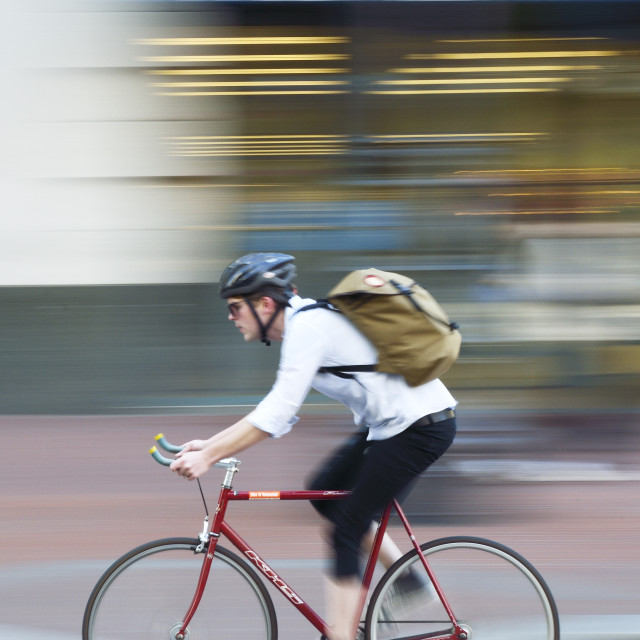 """""""Panning shot of a cyclist"""" stock image"""