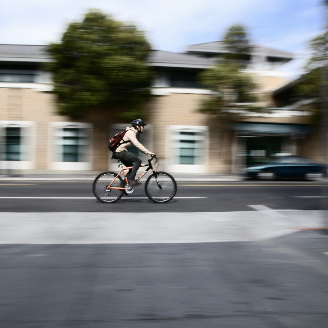 """Cyclist with panning blur"" stock image"