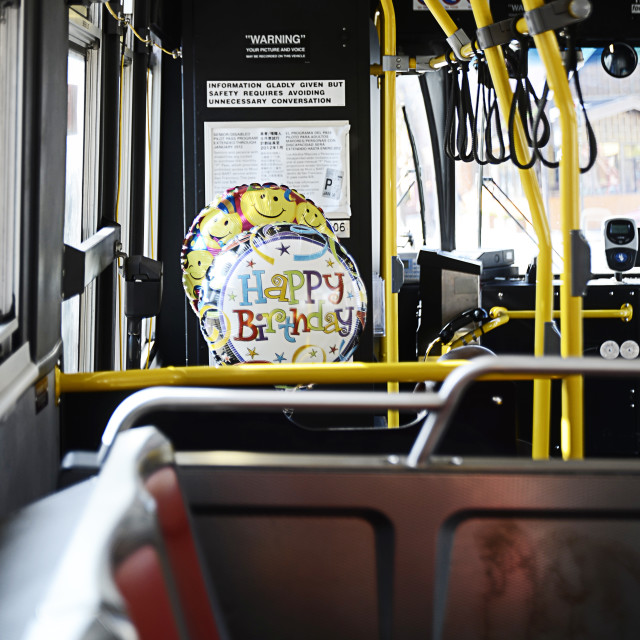 """Birthday balloons on a public bus"" stock image"