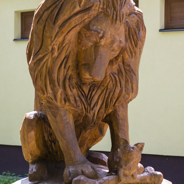 """""""Carved statue of a lion and a dog."""" stock image"""