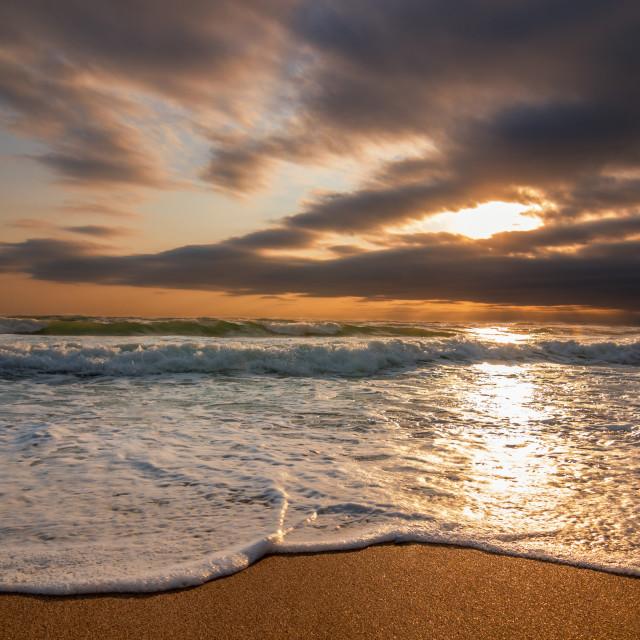 """Colorful ocean beach sunrise."" stock image"