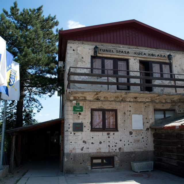 """Sarajevo, Bosnia - July 7, 2016: The house through which Sarajevo Tunnel connected the city with other parts during the Siege of Sarajevo constructed in 1993. Note the bullet holes on walls."" stock image"