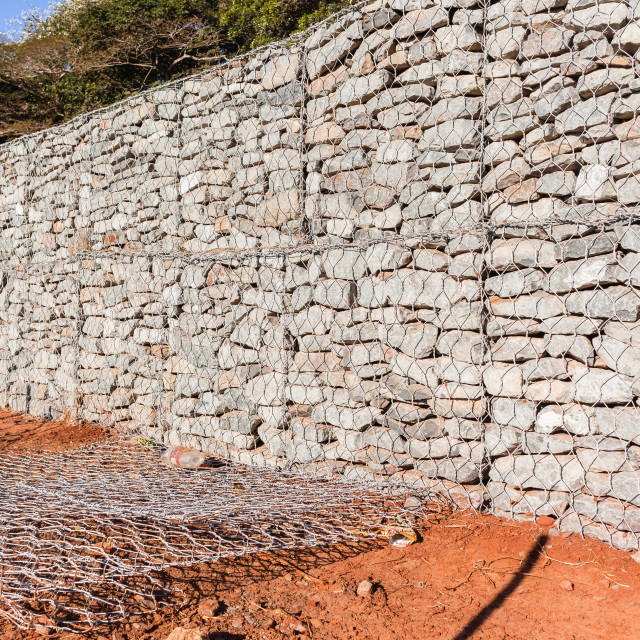 """Stone Wire Cage Wall"" stock image"