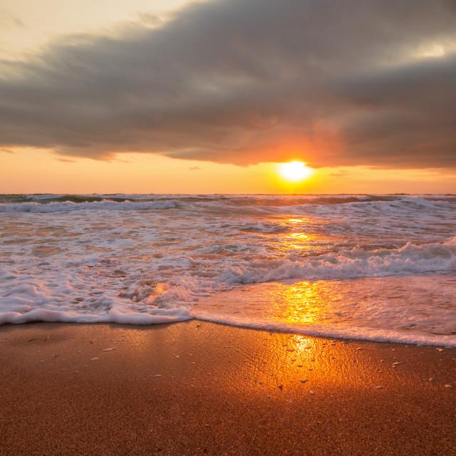 """Colorful ocean beach sunrise"" stock image"