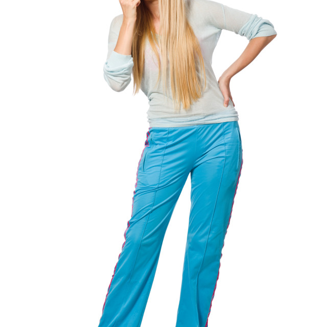 """Young woman wearing blue training pants isolated on white"" stock image"