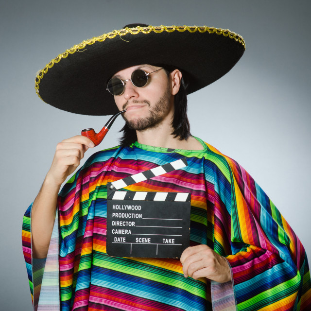 """""""Mexican man with movie board"""" stock image"""