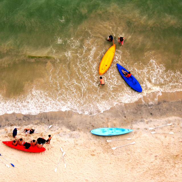 """Looking down from above at canoe sports enthusiasts at the beach in Batu Ferringhi, Penang, Malaysia."" stock image"