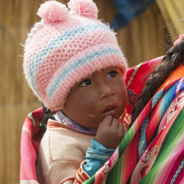 """Adorable baby in colorful cloth in Peru"" stock image"