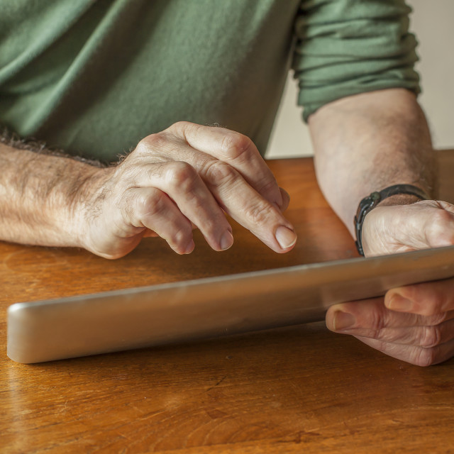 """""""Man working with digital tablet"""" stock image"""