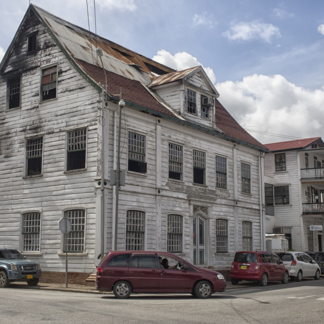 """Run down building with fire damage in Paramaribo"" stock image"