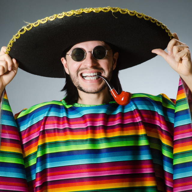 """""""Mexican smoking pipe wearing sombrero"""" stock image"""