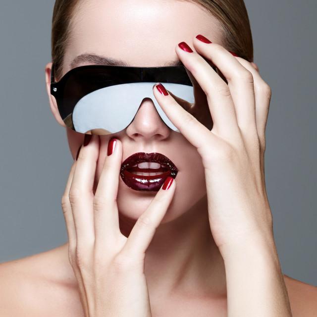 """Girl blonde in black sunglasses."" stock image"