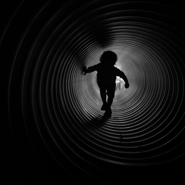 """""""A boy in a tunnel"""" stock image"""