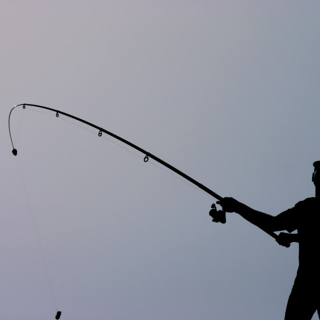 """""""silhouette of a fisherman"""" stock image"""