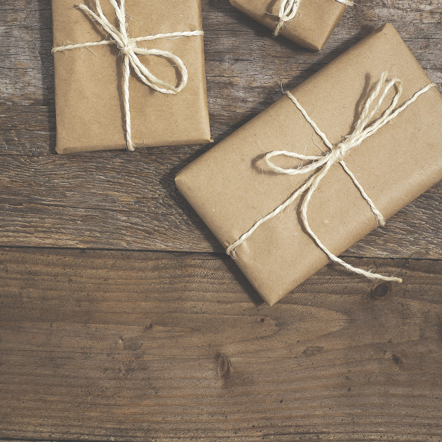 """""""Three gifts wrapped in brown paper"""" stock image"""