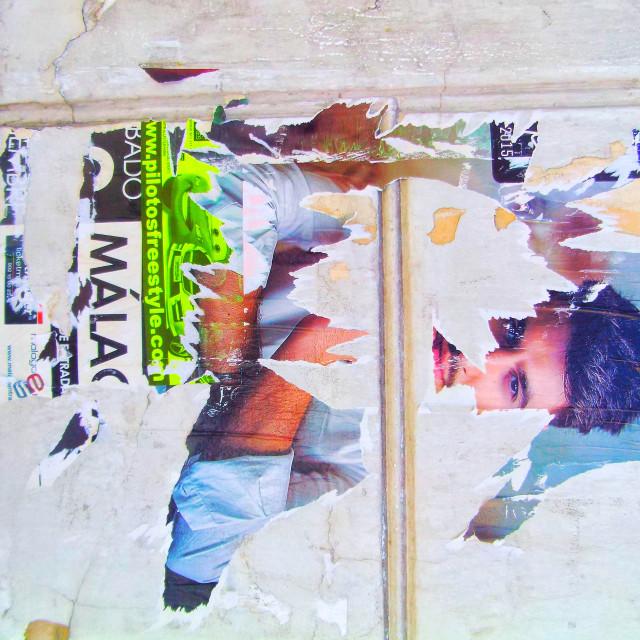 """Torn poster Malaga"" stock image"