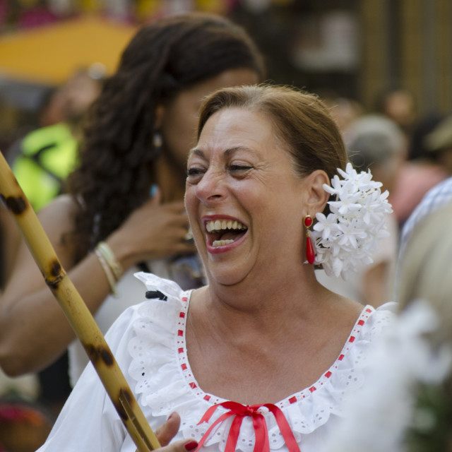 """Spanish woman in traditional dress laughing"" stock image"