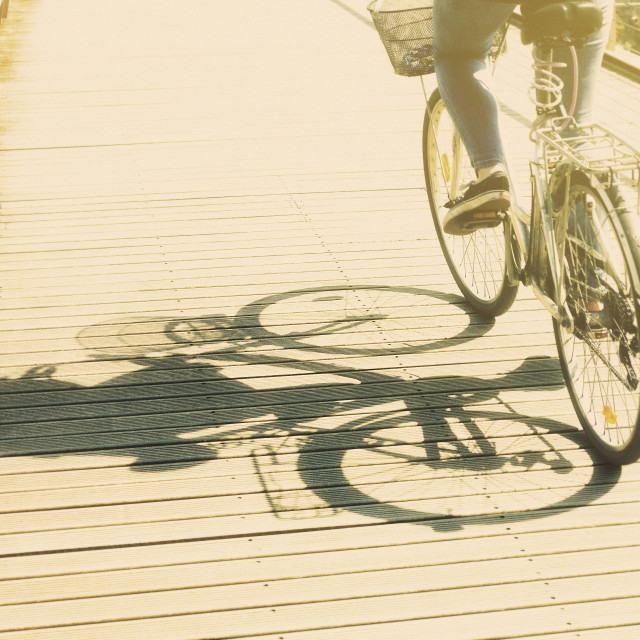 """Shadow girl bike"" stock image"