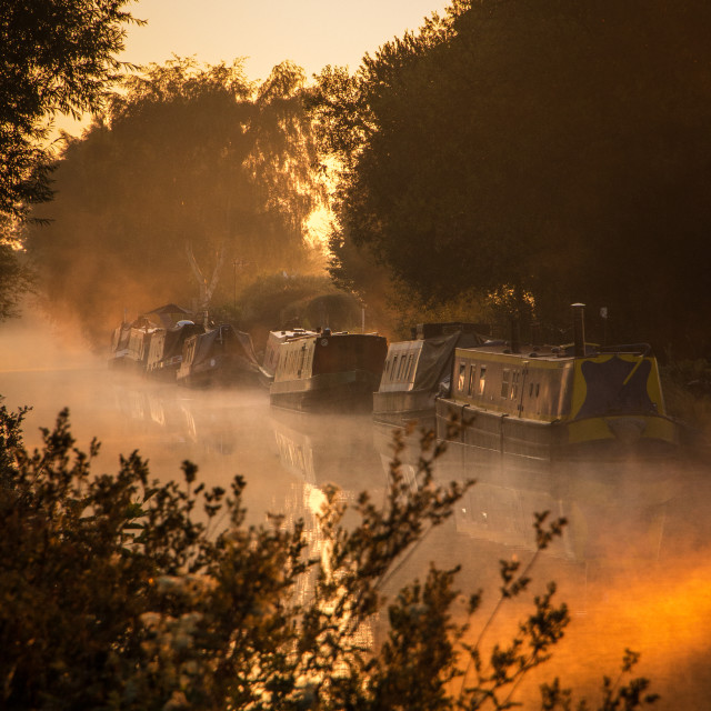 """Canal boats at sunrise"" stock image"