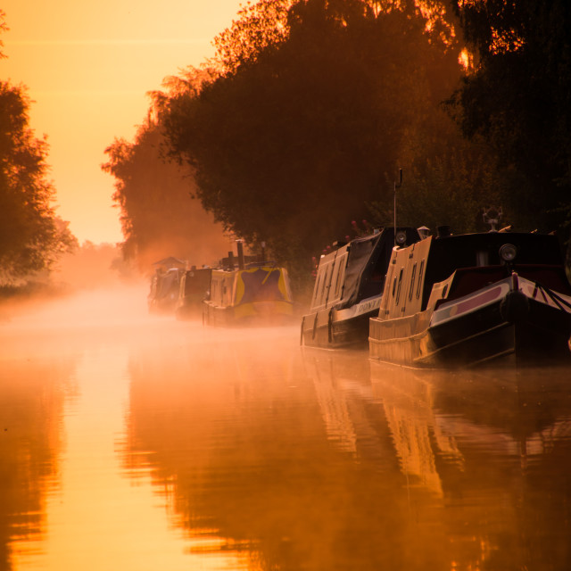 """Canal boats in golden hour sunrise"" stock image"