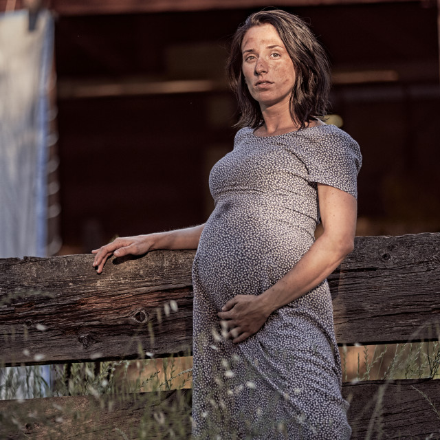 """A Pregnant Woman Resting After Work on a Ranch."" stock image"