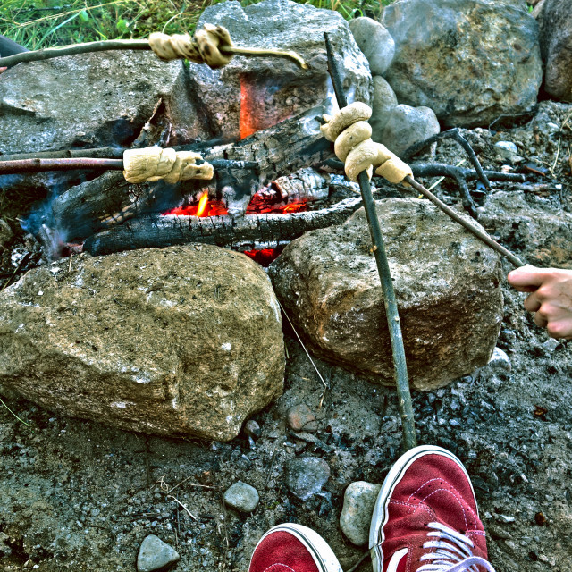 """""""Sharing some stories around the fire"""" stock image"""